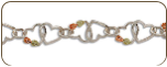 Sterling Silver Bracelet with Dual Hearts and Black Hills Gold Leaves (SKU: BR3101SS)